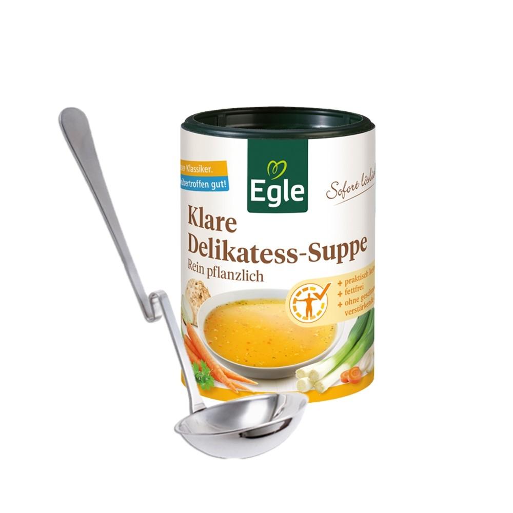 Delikatess-Suppe und Servierkelle mit Knick